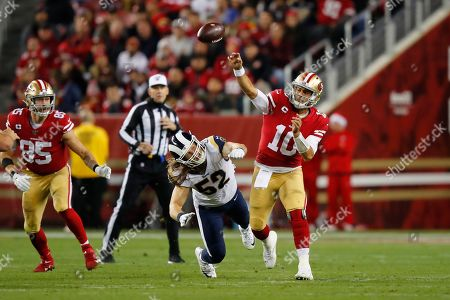 San Francisco 49ers quarterback Jimmy Garoppolo (10) passes in front of Los Angeles Rams outside linebacker Clay Matthews (52) during the second half of an NFL football game in Santa Clara, Calif