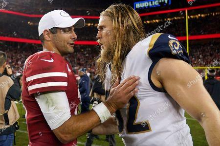 San Francisco 49ers quarterback Jimmy Garoppolo, left, talks with Los Angeles Rams outside linebacker Clay Matthews after an NFL football game in Santa Clara, Calif