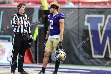 Washington Huskies wide receiver Aaron Fuller (2) speak with the back judge prior to the start of the 28th edition of the Mitsubishi Motors Las Vegas Bowl game featuring the Boise State Broncos and the Washington Huskies at Sam Boyd Stadium in Las Vegas, NV