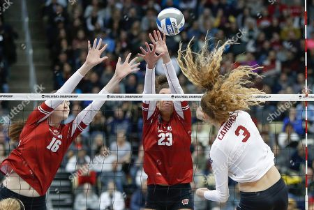 Stanford's Holly Campbell (3) tries to spike through the block efforts of Wisconsin's Dana Rettke (16) and Molly Haggerty (23) during the NCAA Division I women's volleyball championship match, in Pittsburgh