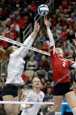 Stock Photo of Wisconsin's Sidney Hilley (2) and Stanford's Holly Campbell, left, work for a point during the NCAA Division I women's volleyball championship match, in Pittsburgh