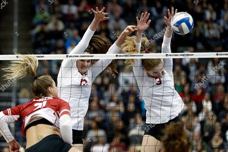 Stanford's Holly Campbell (3) and Audriana Fitzmorris (12) block a spike by Wisconsin's Grace Loberg (21) during the NCAA Division I women's volleyball championship match, in Pittsburgh