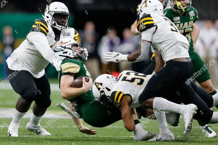 Appalachian State defensive lineman Demetrius Taylor, left, and linebacker D'Marco Jackson (52) bring down UAB quarterback Tyler Johnston III during the second half of the New Orleans Bowl NCAA college football game in New Orleans