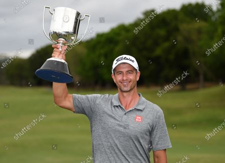 Australian golfer Adam Scott poses with the trophy after winning the 2019 Australian PGA Championship at the RACV Royal Pines Resort on the Gold Coast, Queensland, Australia, 22 December 2019.