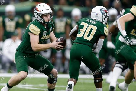 Stock Photo of UAB quarterback Tyler Johnston III (17) prepares to throw the ball during the first half of the New Orleans Bowl NCAA college football game against Appalachian State in New Orleans