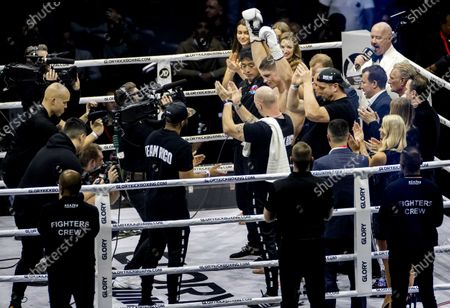 Dutch kickboxer Rico Verhoeven (C-R) celebrates his win over Moroccan-Dutch kickboxer Badr Hari at the end of their rematch of the Glory Collision Heavyweight Championship Bout at GelreDome Stadium in Arnhem, The Netherlands, 21 December 2019. They competed for the world title after Verhoeven was declared the winner three years ago.