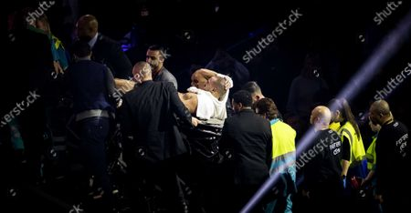 Moroccan-Dutch kickboxer Badr Hari (C) leaves after being injured during his rematch of the Glory Collision Heavyweight Championship Bout against Dutch kickboxer Rico Verhoeven at GelreDome Stadium in Arnhem, The Netherlands, 21 December 2019. They competed for the world title after Verhoeven was declared the winner three years ago.
