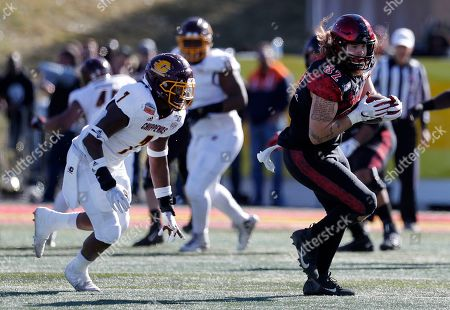 Parker Houston, Michael Oliver. San Diego State tight end Parker Houston (82) carries the ball followed by Central Michigan linebacker Michael Oliver (7) during the first half of the New Mexico Bowl NCAA college football game on in Albuquerque, N.M