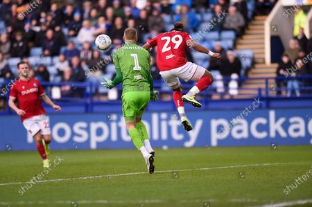 Daniel James Bentley of Bristol City FC and Ashley Williams of Bristol City FC attempt to clear a dangerous ball during the EFL Sky Bet Championship match between Sheffield Wednesday and Bristol City at Hillsborough, Sheffield