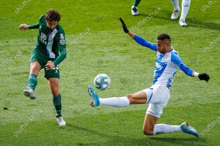 CD Leganes' Youssef En-Nesyri (R) in action against RCD Espanyol's Esteban Granero (L) during the Spanish LaLiga soccer match between CD Leganes and RCD Espanyol at Butarque stadium in Leganes, Madrid, Spain, 22 December 2019.