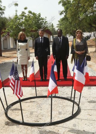 French President Emmanuel Macron (2-L) and his wife Brigitte Macron (L) with Ivory Coast President Alassane Ouattara (2-R) and his wife Dominique (R) pay homage to the French and U.S. soldiers killed in 2004, as they visit the city of Bouake, Ivory Coast, 22 December 2019. President Macron began his official three-day visit to Ivory Coast where he meets with president President of Ivory Coast Alassane Ouattara, before visiting Niger. The visit is expected to bolster economic ties with the former colony as well as focus on security issues within the region.