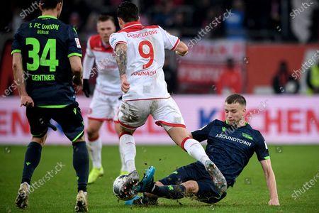 Union's Marvin Friedrich (R) in action against Duesseldorf's Dawid Kownacki (C) during the German Bundesliga soccer match between Fortuna Duesseldorf and FC Union Berlin in Duesseldorf, Germany, 22 December 2019.