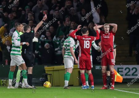 Referee Euan Anderson shows a straight red card to Sam Cosgrove of Aberdeen for a challenge on Kristoffer Ajer of Celtic, during the Ladbrokes Scottish Premiership match between Celtic & Aberdeen at Celtic Park, Glasgow on 21 December 2019
