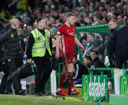 Sam Cosgrove of Aberdeen walks towards the tunnel after being sent off by Referee Euan Anderson for a challenge on Kristoffer Ajer of Celtic, during the Ladbrokes Scottish Premiership match between Celtic & Aberdeen at Celtic Park, Glasgow on 21 December 2019