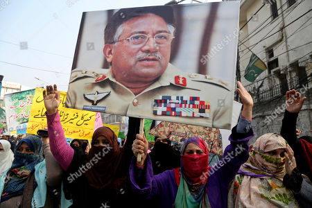 Stock Picture of Supporters of former Pakistani military ruler Gen. Pervez Musharraf protest a court's decision, in Lahore, Pakistan, . The Pakistani court's decision announced Dec. 17 sentenced Musharraf to death in a treason case related to the state of emergency he imposed in 2007 while in power, officials said. Musharraf is apparently sick and receiving treatment in Dubai where he lives