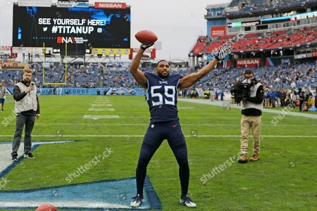 Tennessee Titans inside linebacker Wesley Woodyard (59) prepares to throw a ball into the stands before an NFL football game against the New Orleans Saints, in Nashville, Tenn
