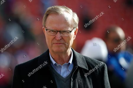 New York Giants owner John Mara walks on the field prior to an NFL football game between the Washington Redskins and the Giants, in Landover, Md