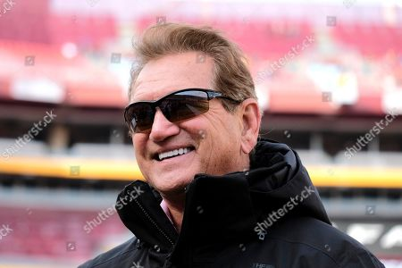 Stock Picture of Former Washington Redskins quarterback Joe Theismann walks on the field prior to an NFL football game between the New York Giants and the Washington Redskins, in Landover, Md