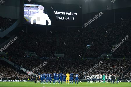 Players pay their tribute to Martin Peters prior to the English Premier League soccer match between Tottenham Hotspur and Chelsea, at the Tottenham Hotspur Stadium in London