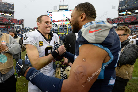New Orleans Saints quarterback Drew Brees (9) talks with Tennessee Titans inside linebacker Wesley Woodyard (59) after an NFL football game, in Nashville, Tenn. The Saints won 38-28