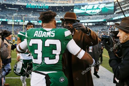 New York Jets strong safety Jamal Adams (33) greets former NFL player Ed Reed after an NFL football game against the Pittsburgh Steelers, in East Rutherford, N.J