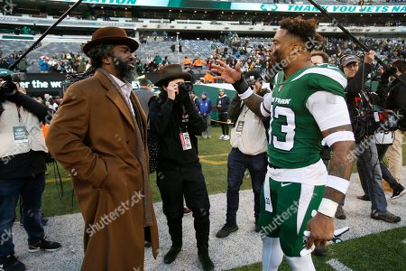 New York Jets strong safety Jamal Adams (33) talks to former NFL player Ed Reed after an NFL football game against the Pittsburgh Steelers, in East Rutherford, N.J