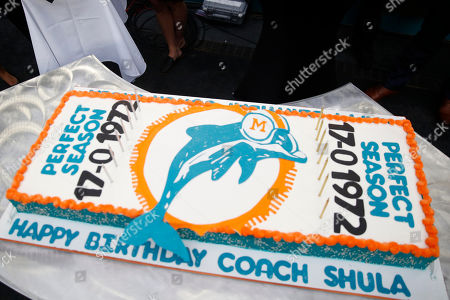 Half time. The 1972 Miami Dolphins and Coach Don Shula cake is displayed during a half time celebration during an NFL football game against the Cincinnati Bengals, in Miami Gardens, Fla