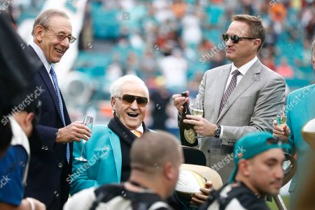 Don Shula, Stephen Ross, Tom Garfinkle. Miami Dolphins owner Stephen Ross, left, toasts, former head coach Don Shula, during a half time celebrating the 1972 undefeated team during at an NFL football game against the Cincinnati Bengals, in Miami Gardens, Fla.To the right is CEO Tom Garfinkel
