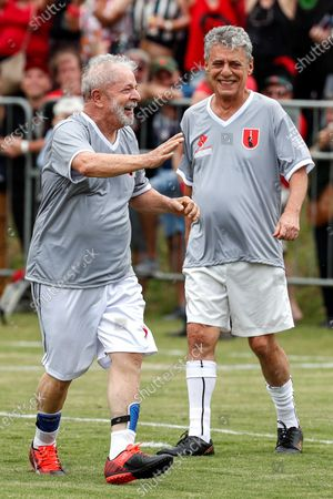 Stock Image of Former Brazilian President Luiz Inacio Lula da Silva (L) celebrates after scoring next to Brazilian musician Chico Buarque during a friendly soccer match as part of Christmas and New Years celebrations, at the school Florestan Fernandes, in Guararema, Brazil, 22 December 2019.