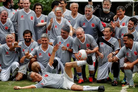 Stock Picture of Former Brazilian President Luiz Inacio Lula da Silva (3-R) celebrates after scoring next to Brazilian musician Chico Buarque (down) during a friendly soccer match as part of Christmas and New Years celebrations, at the school Florestan Fernandes, in Guararema, Brazil, 22 December 2019.