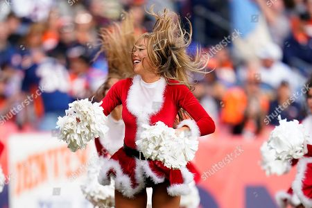 The Denver Broncos cheerleaders perform during the first half of an NFL football game against the Detroit Lions, in Denver