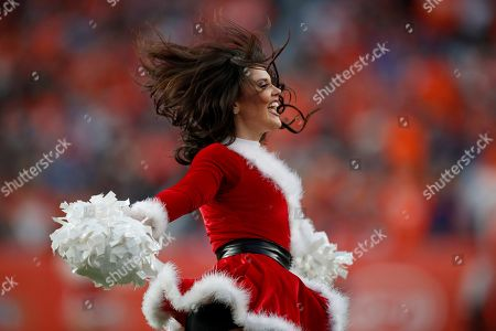The Denver Broncos cheerleaders perform during the second half of an NFL football game against the Detroit Lions, in Denver