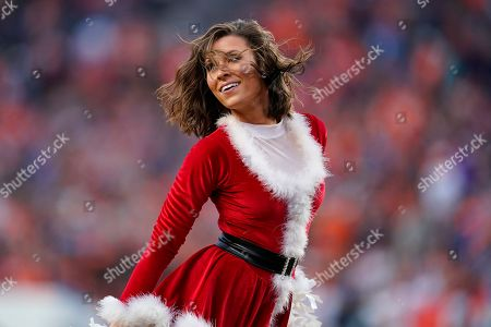 Stock Image of The Denver Broncos cheerleaders perform during the second half of an NFL football game against the Detroit Lions, in Denver