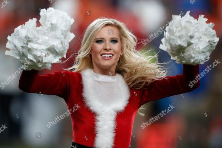 Stock Picture of The Denver Broncos cheerleaders perform during the second half of an NFL football game against the Detroit Lions, in Denver. The Broncos won 27-17