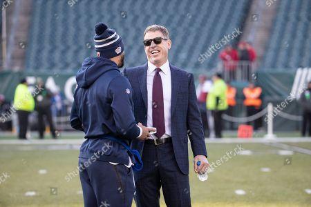 Former Dallas Cowboys player Troy Aikman meets with Dallas Cowboys quarterback Dak Prescott ahead of an NFL football game against the Philadelphia Eagles, in Philadelphia