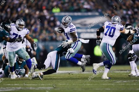Philadelphia Eagles free safety Rodney McLeod tries to stop Dallas Cowboys running back Ezekiel Elliott (21) during the second half of an NFL football game, in Philadelphia