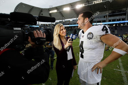 Melanie Collins, a CBS sideline reporter interviews Oakland Raiders quarterback Derek Carr after an NFL football game against the Los Angeles Chargers, in Carson, Calif