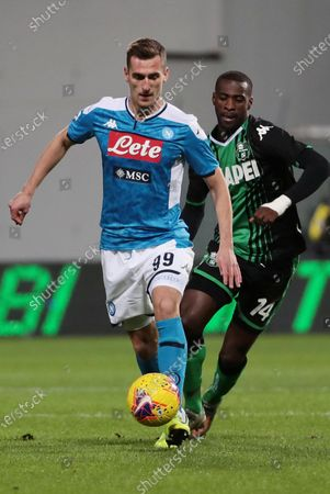 Stock Image of Sassuolo's Pedro Obiang  (R) and Napoli's Arkadiusz Milik (L) in action during the Italian Serie A soccer match US Sassuolo vs SSC Napoli at Mapei Stadium in Reggio Emilia, Italy, 22 December 2019.