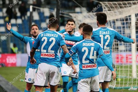 Stock Photo of Napoli's players jubilate after the 1-2 goal (own goal by Pedro Obiang) during the Italian Serie A soccer match US Sassuolo vs SSC Napoli at Mapei Stadium in Reggio Emilia, Italy, 22 December 2019.