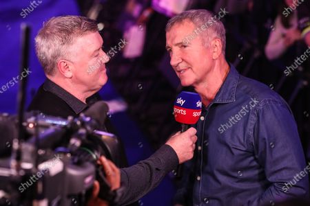 Stock Image of Graeme Souness being interviewed by Geoff Shreeves during the PDC William Hill World Darts Championship at Alexandra Palace, London