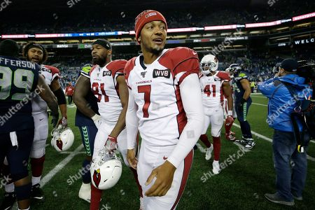 Arizona Cardinals quarterback Brett Hundley walks off the field after an NFL football game against the Seattle Seahawks, in Seattle. The Cardinals won 27-13