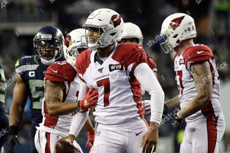 Arizona Cardinals quarterback Brett Hundley (7) reacts after making a 14-yard run on a keeper play during the second half of an NFL football game against the Seattle Seahawks, in Seattle