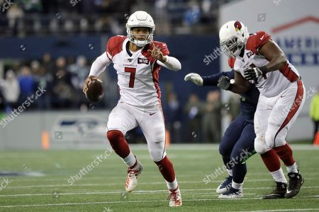 Arizona Cardinals quarterback Brett Hundley (7) keeps the ball during the second half of an NFL football game against the Seattle Seahawks, in Seattle