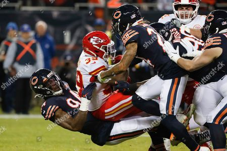 Kansas City Chiefs running back Spencer Ware (39) is pulled back by Chicago Bears outside linebacker Leonard Floyd (94) in the first half of an NFL football game in Chicago