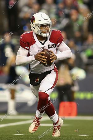 Arizona Cardinals quarterback Brett Hundley (7) rolls out of the pocket during a game between the Arizona Cardinals and Seattle Seahawks at CenturyLink Field in Seattle, WA. The Cardinals defeated the Seahawks 27-13