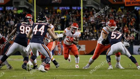 Kansas City Chiefs running back Spencer Ware (39) runs against the Chicago Bears in the first half of an NFL football game in Chicago