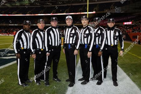 Field judge Michael Banks (72), from left, line judge Jeff Seeman (45), down judge Danny Shirt (113), referee Carl Cheffers (51), umpire Mark Pellis (131), field judge Eugene Hall (103) and umpire Undrey Wash (96) pose for a group portrait before an NFL football game between the Chicago Bears ;and Kansas City Chiefs in Chicago