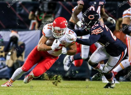 Stock Image of Chicago Bears cornerback Prince Amukamara (R) reaches to tackle Kansas City Chiefs tight end Travis Kelce (L) during the NFL American Football game between the Kansas City Chiefs and the Chicago Bears at Soldier Field in Chicago, Illinois, USA, 22 December 2019.
