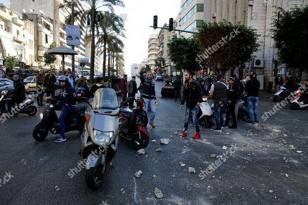Supporters of caretaker Lebanese Prime Minister Saad Hariri block a main road in Beirut, Lebanon