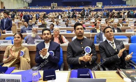 From left, Keerthy Suresh, who received the best actress award, actors Ayushmann Khurrana and Vicky Kaushal who shared the best actor award and Bollywood star Akshay Kumar, applaud during the national film awards ceremony in New Delhi, India, Monday, Dec.23, 2019